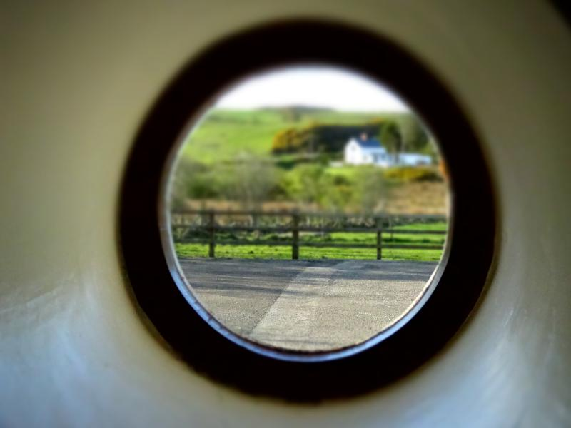 Porthole window which gives the cottage its name