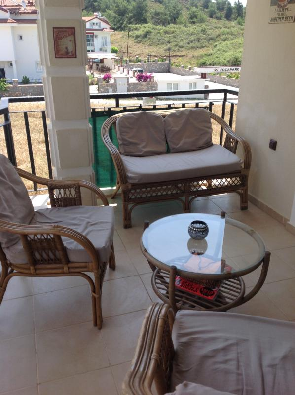 Large relaxing balcony leading from kitchen