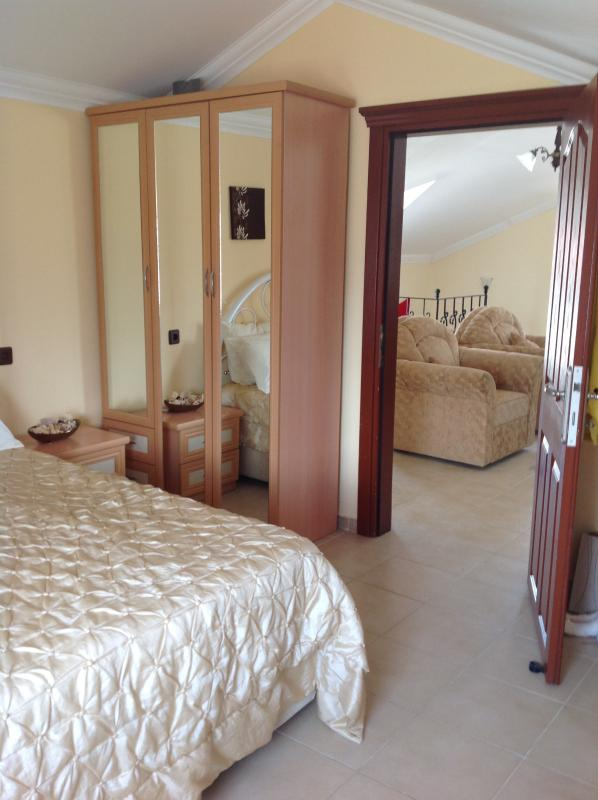 Double bedroom with wardrobe and fitted cupboards