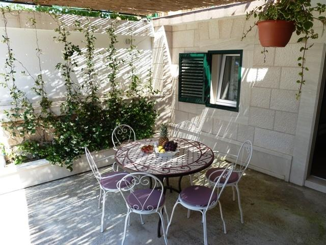 Enjoy sitting in a shade of a private garden