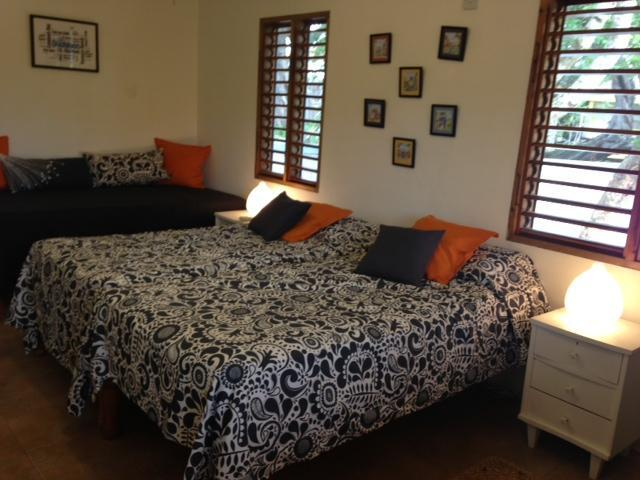 The pool view bedroom, which can sleep three, has a/c, en-suite bathroom and window mosquito nets