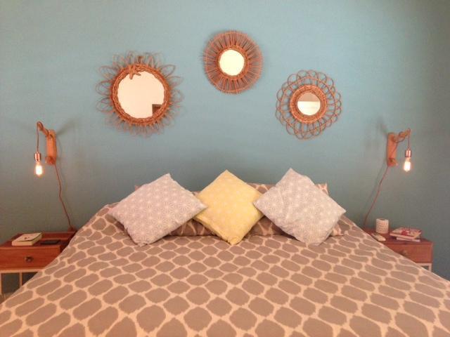 Sunrise bedroom with full length doors opening onto pool, a/c, window nets and en-suite bathroom