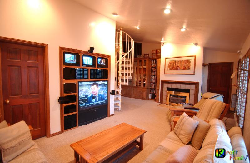 Living room with entertainment center (4 TVs), fireplace, & massage chair