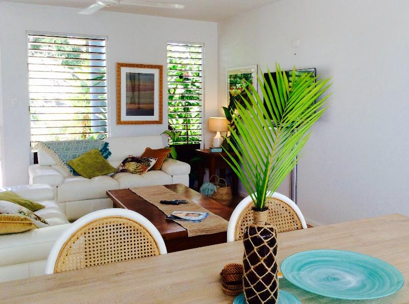 A spacious dining area to sit down for a meal or a board game with family and friends