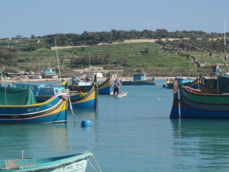 Marsaxlokk seaside with traditional Luzzu boats