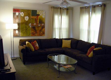 Living Room has TV and comfortable seating.