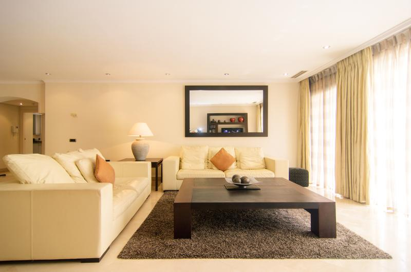 Very large wooden coffee table in lounge area