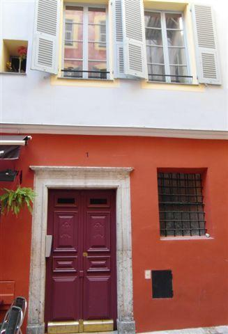 The front door and building on the quiet small square of Place Vielle