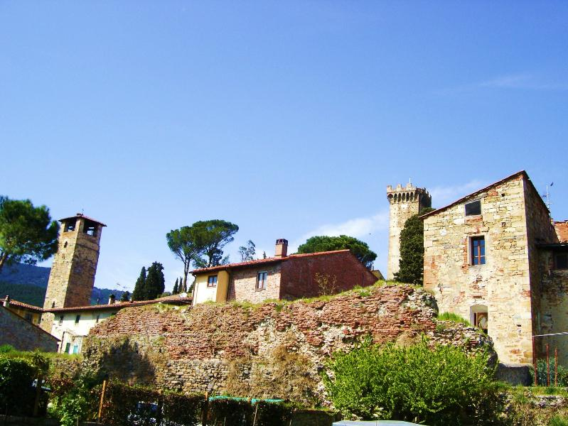 Rear view of Casa Colomba with 12th Century medieval tower to the right