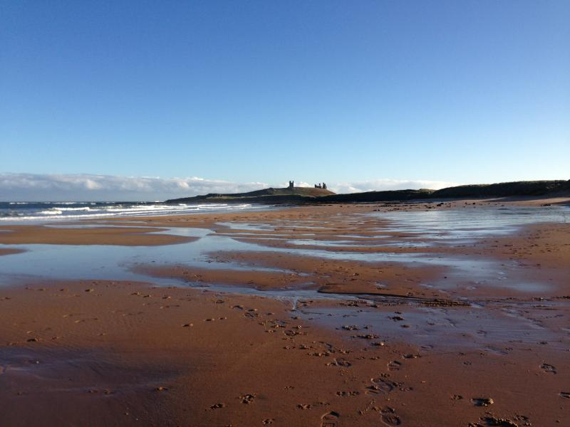 Golden sands of Embleton Bay in the early morning sun