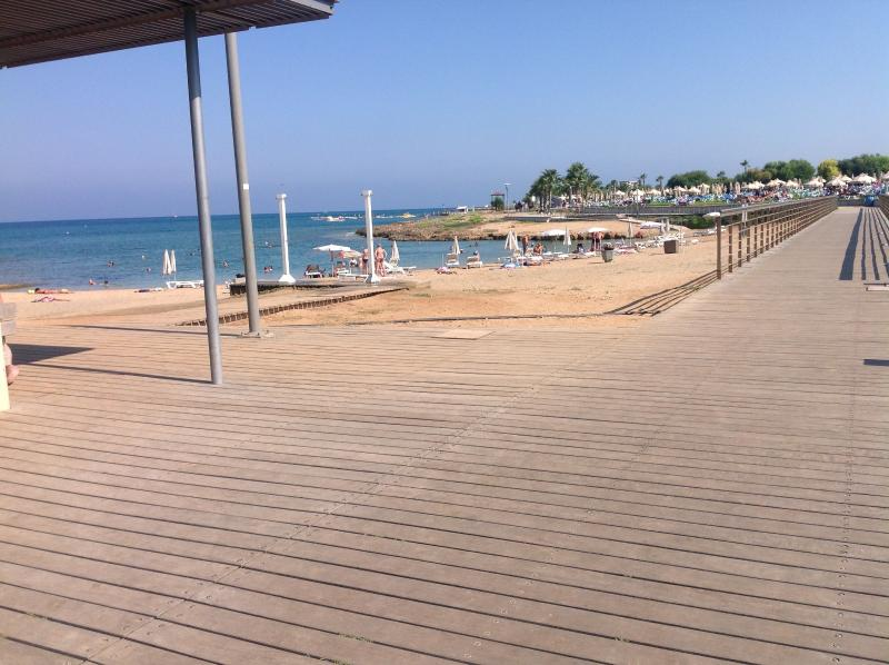 Continue walking along the coast on the boardwalk with its cafes/bars all the way to Protaras