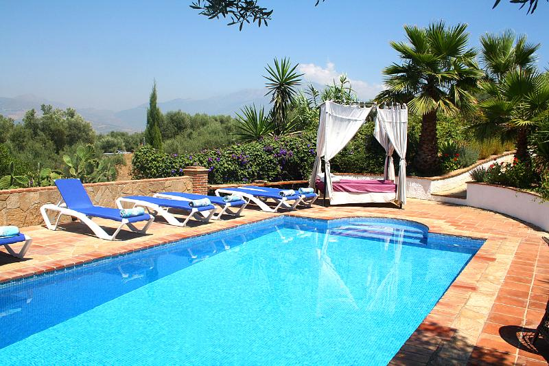 Comfortable sunloungers and a big daybed