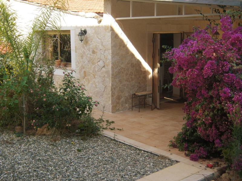 Holiday home by the sea with a beautiful garden