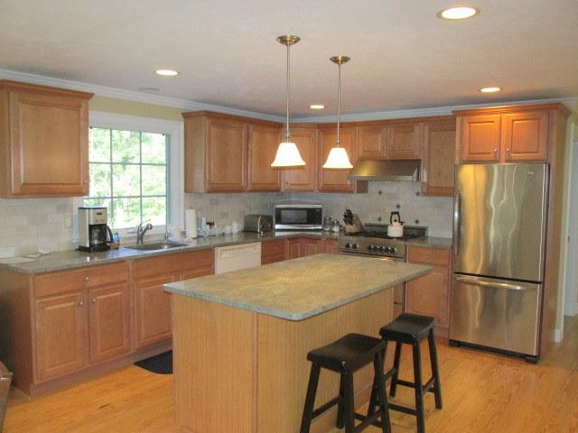Beautiful kitchen with granite counters and high end stainless appliances