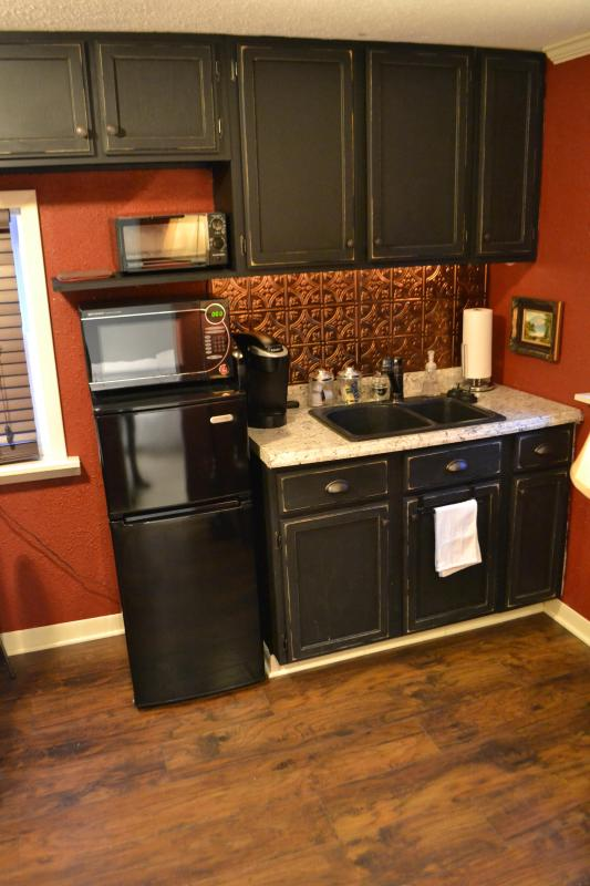 Kitchenette area with refrigerator/freezer, toaster oven, Keurig & microwave.