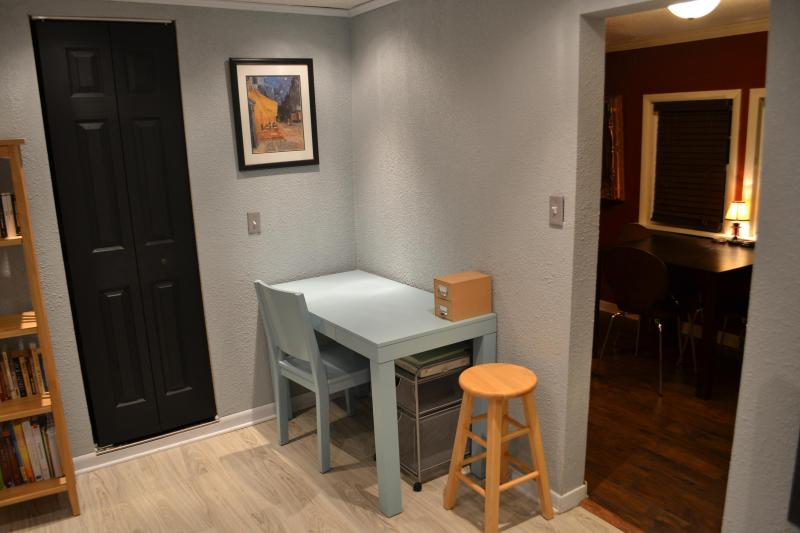 Bedroom desk is spacious. Variety of seating options available in the studio.