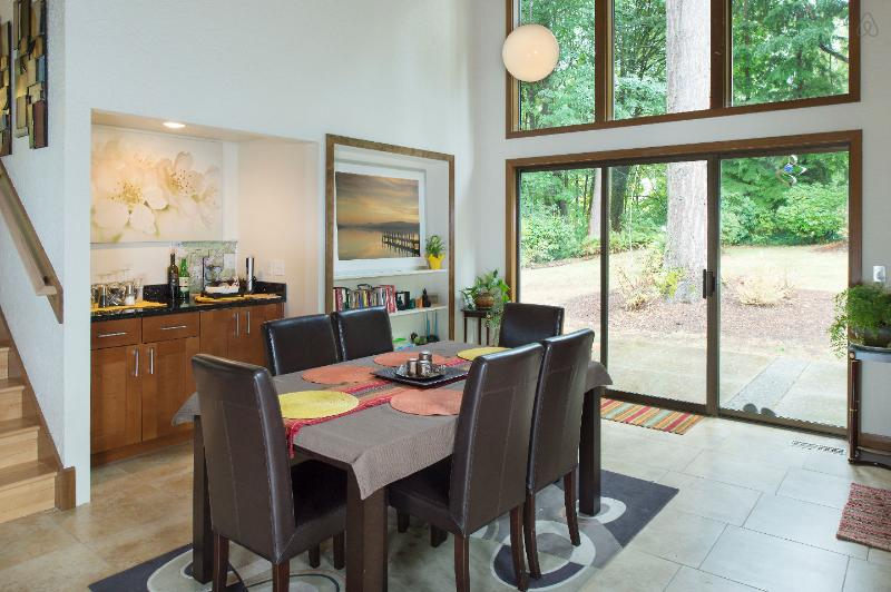 Roomy dining space viewing the woodlands