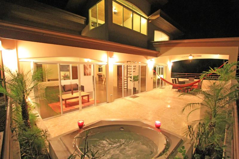 The expansive tropical balcony with hot/cold jacuzzi.