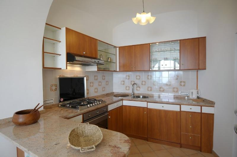 Kitchen corner with access to the spacious balcony with sea view