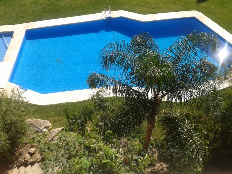 view of one of the swimming pools from the balcony