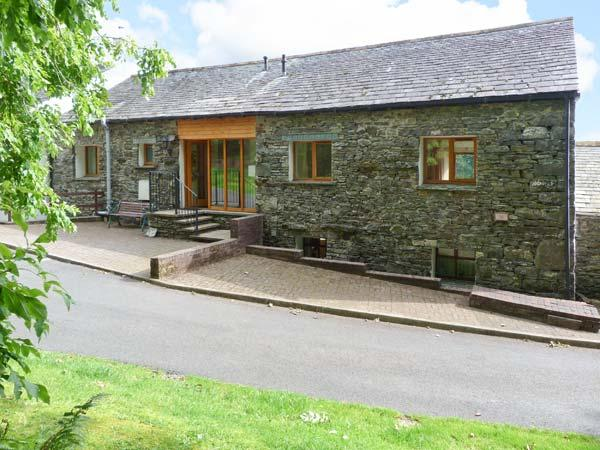 SWALLOW'S NEST, converted barn, ground floor, en-suite facility, gas fire, holiday rental in Lorton