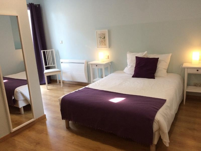 Comfortable double bedroom with ensure shower and flat screen TV.