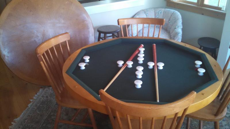 The dinig table converts to bumper pool or a card table for some indoor fun on a rainy day.
