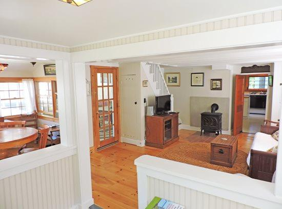 The living room with DirecTV and gas stove