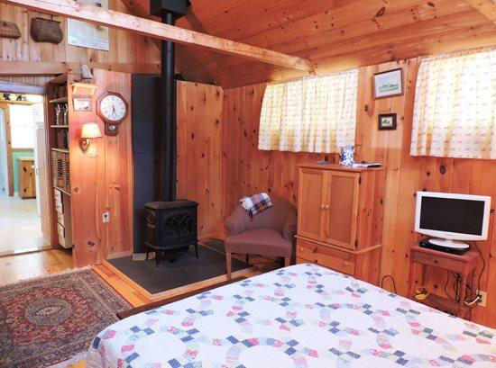 Queen bedroom on first floor with gas stove and cottage feel