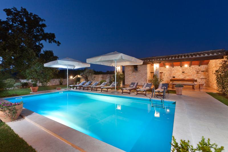 Pool lighting creates a magical outdoor environment.