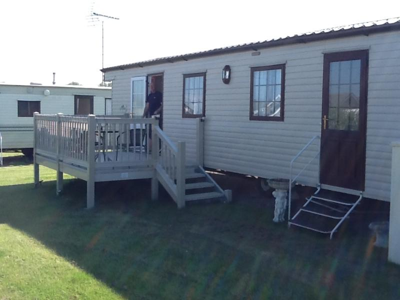 The exterior of our caravan with decking for those sunny days.