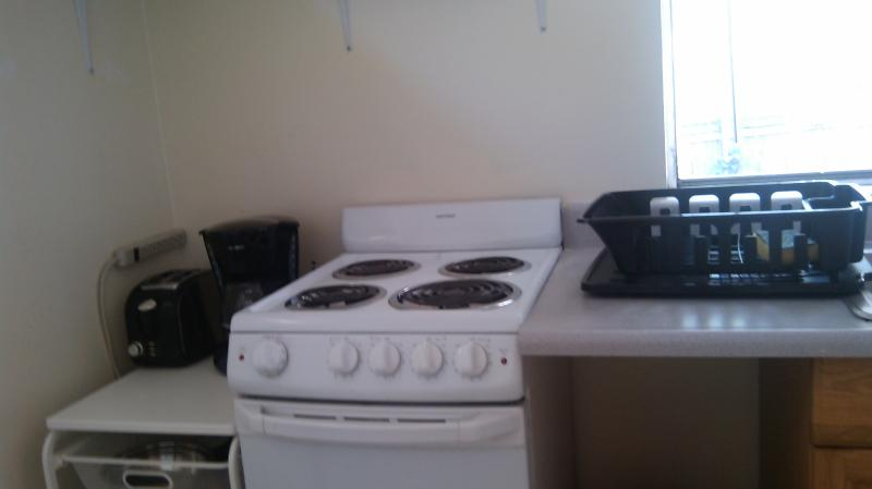 Fully equipped kitchen with dining area, full size refrigerator, microwave stove, dishes, pots, ect.