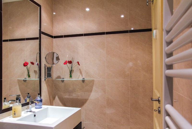 Enjoy your own power shower and elegant marble featured bathroom.