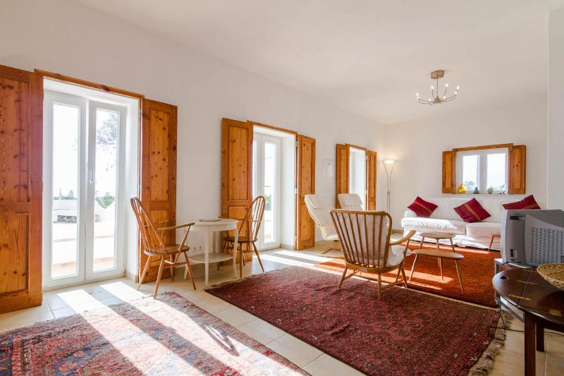 French windows in the sitting room lead onto the varanda