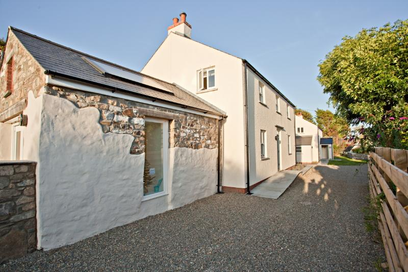 Boathouse cottage and original stone sun room. Access is via a quiet lane but plenty of room to park
