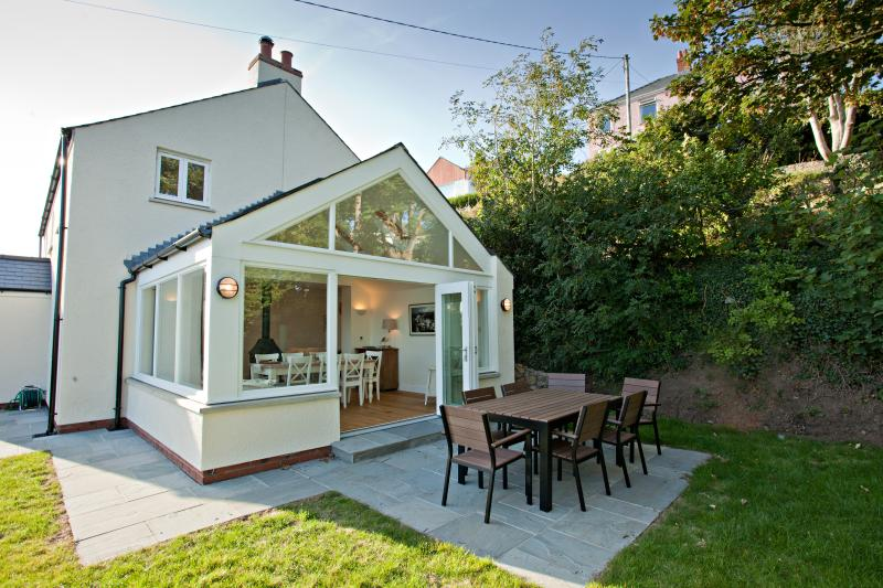 The sun room with the bi-folding doors opening on to the patio area-lovely for al fresco dining!