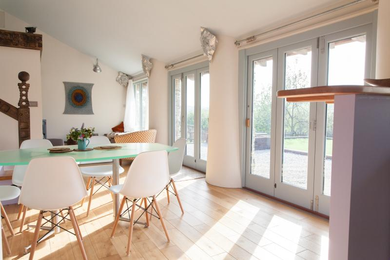 The wonderfully light and airy South facing living, dining, kitchen is still cosy in the Winter