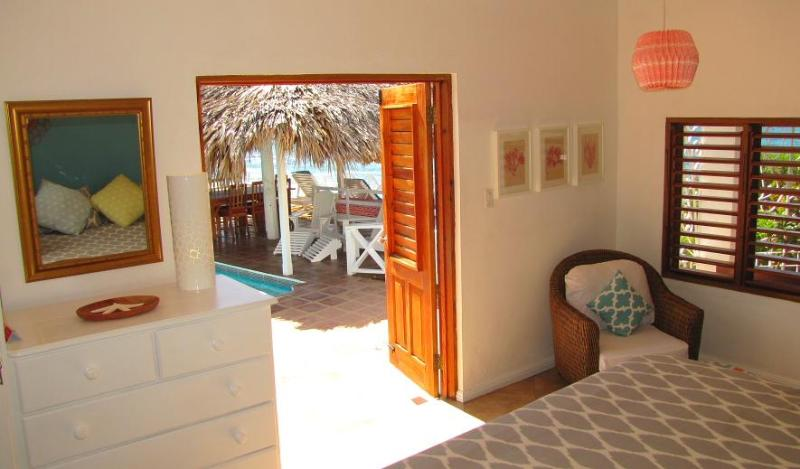 Roll out of the sunrise bedroom, straight into the pool.  This room has fantastic views from 3 sides