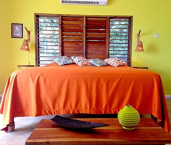The sunset bedroom has a/c, mosquito nets on windows and an en-suite bathroom and 'secret' veranda