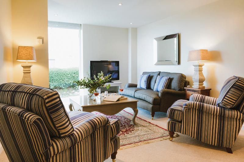 Open plan living and dining area with comfy sofas, bose music system and smart TV