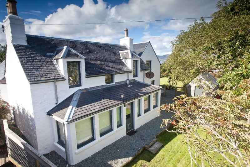 A fully renovated traditional cottage set in private garden with direct access to the beach.