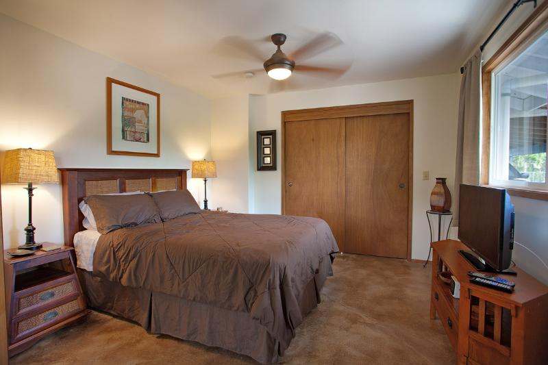 Queen size bed  with 42' TV and DISH cable.