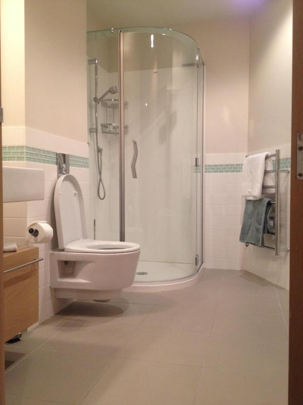 Tiled Bathroom with Separate Shower and Bath