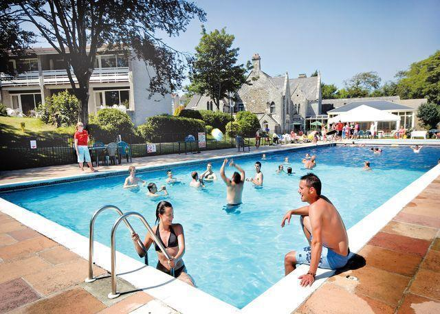 HUGE OUTDOOR SWIMMING POOL -  PERFECT FOR FUN TIMES TOGETHER DURING THE SUMMER MONTHS (SEASONAL)