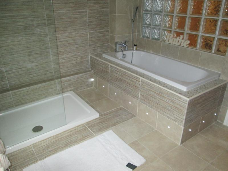 Large luxury bathroom with walk in shower and separate bath
