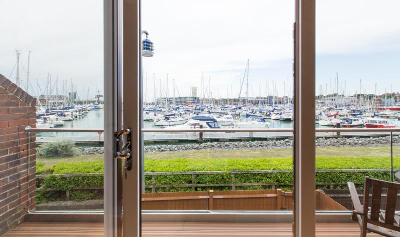 View from lounge onto balcony and marina beyond