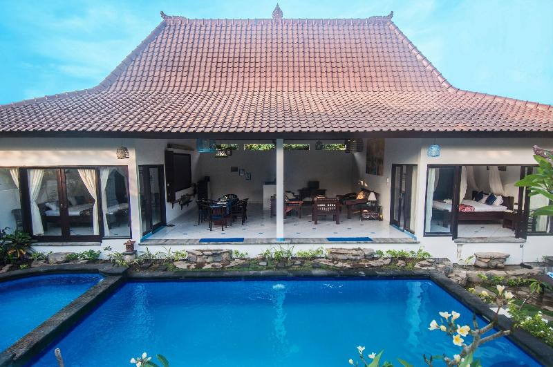 Ambary House features semi open and spacious space, traditional architecture, large pool and library