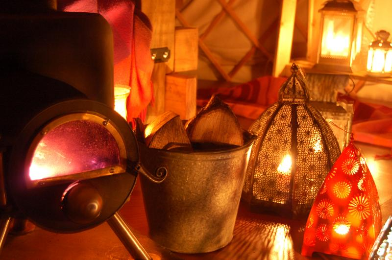 The Secret Yurts log burner and lanterns to keep you cosy!