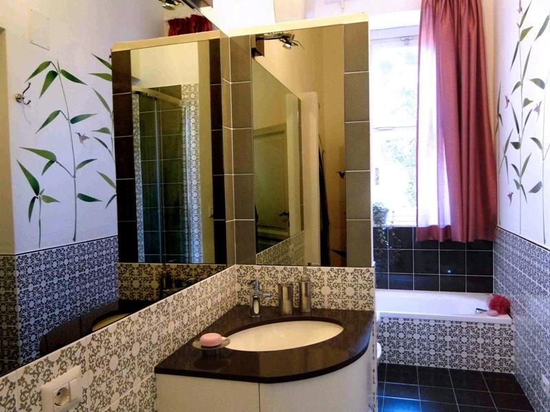 The bathroom with shower cabine and bath
