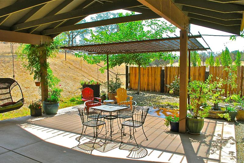 Covered Patio off Bedroom w/ Arbor, Swing, & Fountain